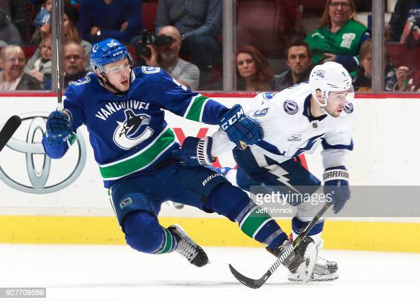 Tyler Johnson of the Tampa Bay Lightning checks Brendan Gaunce of the Vancouver Canucks during their NHL game at Rogers Arena February 3 2018 in...
