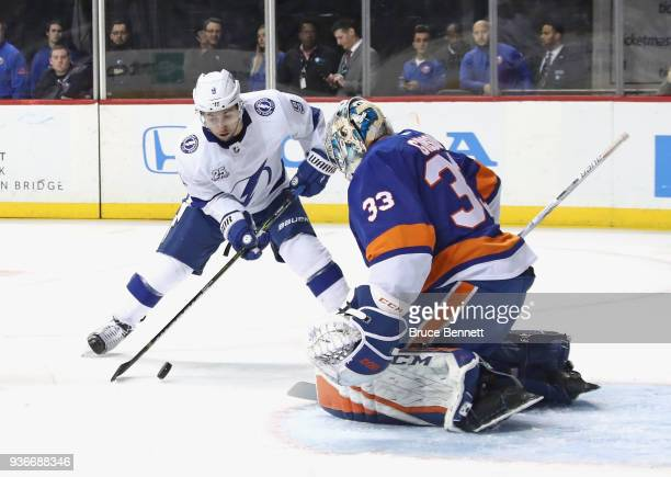 Tyler Johnson of the Tampa Bay Lightning is stopped by Christopher Gibson of the New York Islanders during the first period at the Barclays Center on...