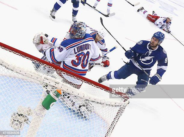 Tyler Johnson of the Tampa Bay Lightning misses a shot against Henrik Lundqvist of the New York Rangers in Game Four of the Eastern Conference Finals...