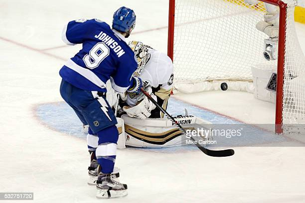 Tyler Johnson of the Tampa Bay Lightning scores a goal against Matt Murray of the Pittsburgh Penguins during the third period in Game Three of the...