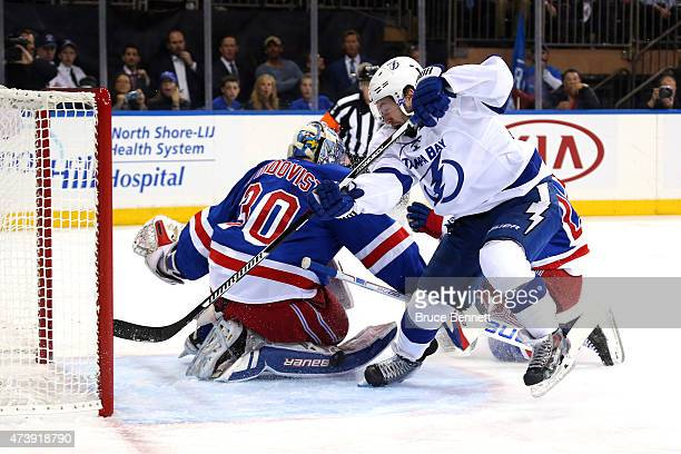 Tyler Johnson of the Tampa Bay Lightning scores a goal in the first period against Henrik Lundqvist of the New York Rangers during Game Two of the...