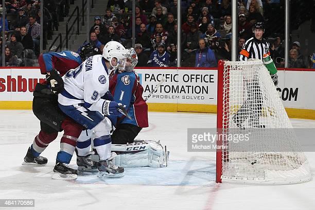 Tyler Johnson of the Tampa Bay Lightning scores against Brad Stuart and goaltender Semyon Varlamov of the Colorado Avalanche at the Pepsi Center on...