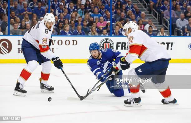 Tyler Johnson of the Tampa Bay Lightning skates against Alex Petrovic of the Florida Panthers during the game at Amalie Arena on October 6 2017 in...