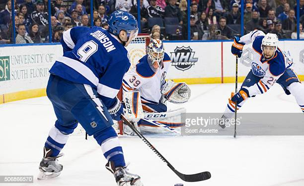 Tyler Johnson of the Tampa Bay Lightning skates against goalie Anders Nilsson and Darnell Nurse of the Edmonton Oilers during the first period at the...