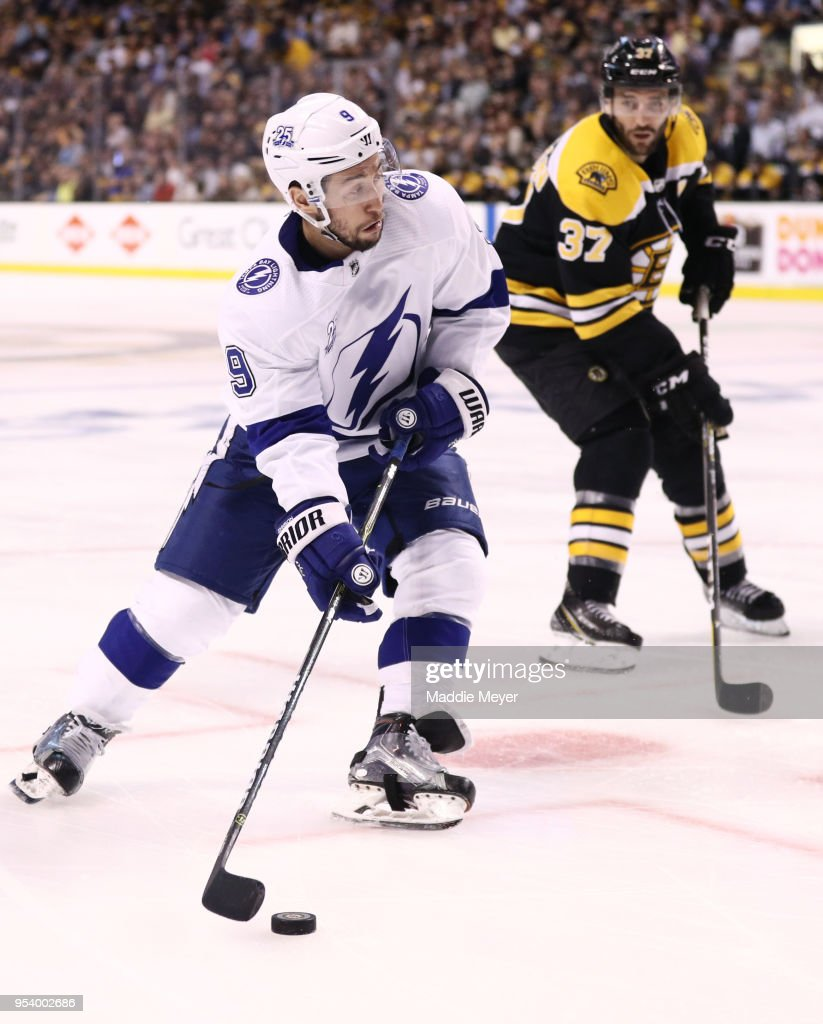 Tyler Johnson #9 of the Tampa Bay Lightning skates against Patrice Bergeron #37 of the Boston Bruins during the second period of Game Three of the Eastern Conference Second Round during the 2018 NHL Stanley Cup Playoffs at TD Garden on May 2, 2018 in Boston, Massachusetts.