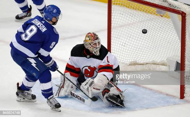 Tyler Johnson of the Tampa Bay Lightning watches the puck fly into the net for a goal against goalie Keith Kinkaid of the New Jersey Devils in Game...
