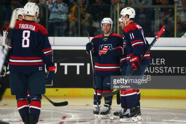 Tyler Johnson of USA celebrates his team's third goal with team mates during the international ice hockey friendly match between Germany and USA at...