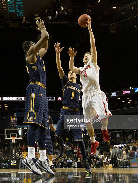 Tyler Kalinoski of the Davidson Wildcats makes the game winning shot over Jerrell Wright of the La Salle Explorers with no time on the clock in the...