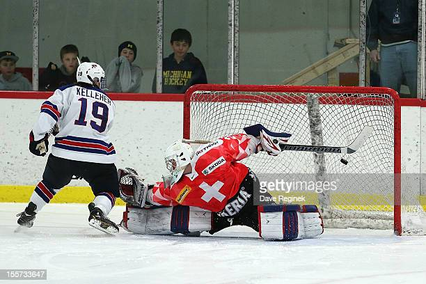 Tyler Kelleher from team USA scores a shoot-out goal on Daniel Guntern of team Switzerland during game two of the U-18 Four Nations Cup on November...