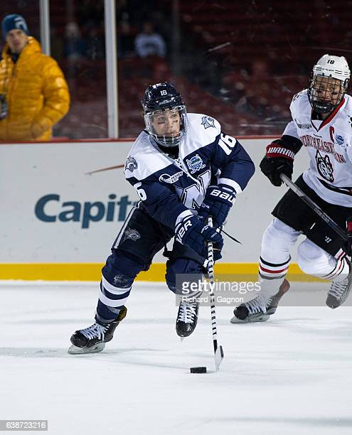 """Tyler Kelleher of the New Hampshire Wildcats skates against the Northeastern Huskies during NCAA hockey at Fenway Park during """"Frozen Fenway"""" on..."""