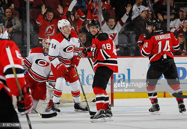Tyler Kennedy of the New Jersey Devils celebrates a goal by Adam Henrique at 1054 of the first period against the Carolina Hurricanes at the...