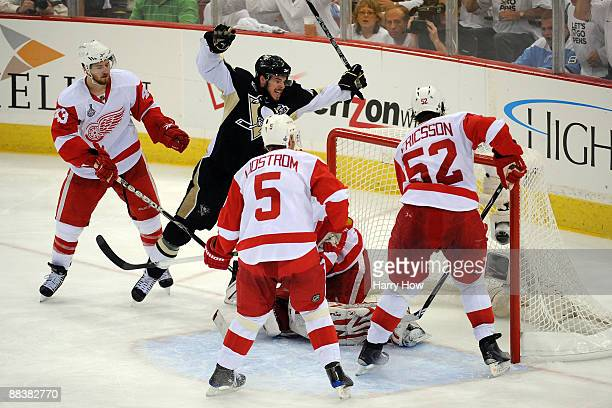 Tyler Kennedy of the Pittsburgh Penguins celebrates after scoring a goal in the third period against Darren Helm Nicklas Lidstrom Jonathan Ericsson...