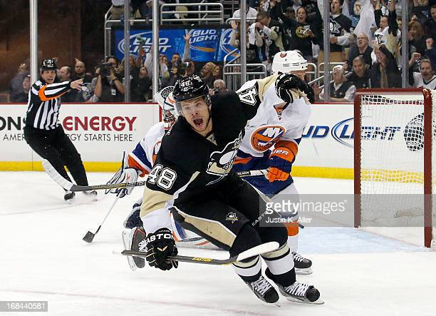 Tyler Kennedy of the Pittsburgh Penguins celebrates his second period goal against the New York Islanders in Game Five of the Eastern Conference...