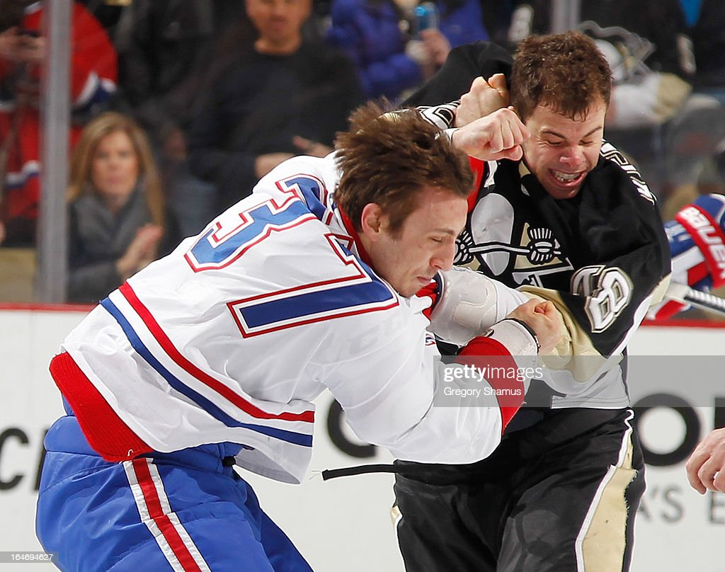 Tyler Kennedy #48 of the Pittsburgh Penguins delivers a punch on Gabriel Dumont #37 of the Montreal Canadiens on March 26, 2013 at Consol Energy Center in Pittsburgh, Pennsylvania. Pittsburgh won the game 1-0.