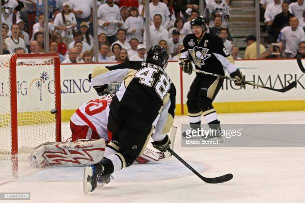 Tyler Kennedy of the Pittsburgh Penguins scores a goal in the second period against Chris Osgood of the Detroit Red Wings during Game Four of the...