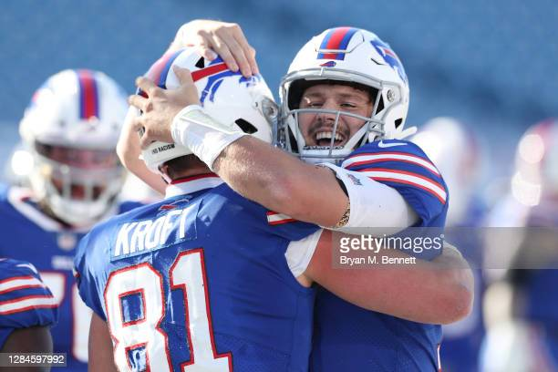 Tyler Kroft of the Buffalo Bills and Josh Allen celebrate a touchdown during the first half against the Seattle Seahawks at Bills Stadium on November...