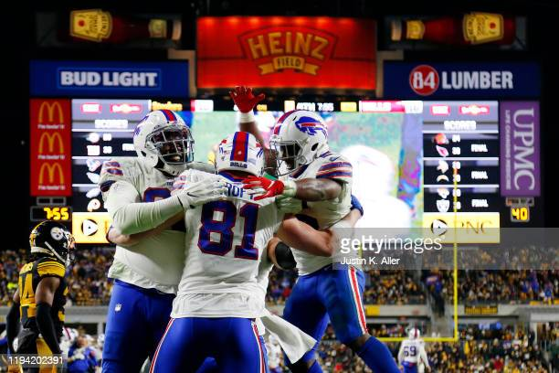 Tyler Kroft of the Buffalo Bills celebrates with teammates after scoring a touchdown during the fourth quarter against the Pittsburgh Steelers in the...