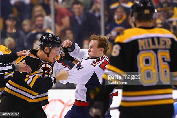 Tyler Lewington of the Washington Capitals and Justin Hickman of the Boston Bruins fight during the second period at TD Garden on September 22 2015...