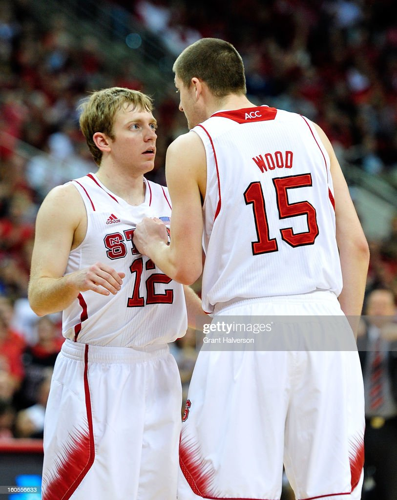 Tyler Lewis #12 and Scott Wood #15 of the North Carolina State Wolfpack huddle during the closing minute of a loss to the Miami Hurricanes at PNC Arena on February 2, 2013 in Raleigh, North Carolina. Miami won 79-78.