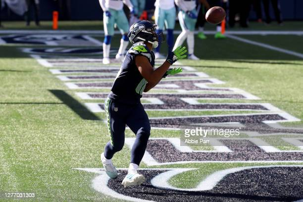 Tyler Lockett of the Seattle Seahawks catches a one yard touchdown pass against the Dallas Cowboys during the second quarter in the game at...