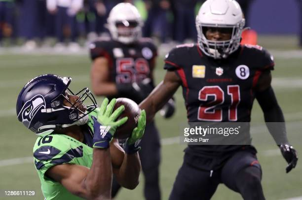 Tyler Lockett of the Seattle Seahawks catches a pass for a touchdown in front of Patrick Peterson of the Arizona Cardinals at Lumen Field on November...