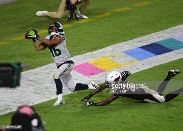 Tyler Lockett of the Seattle Seahawks catches a touchdown pass against Dre Kirkpatrick of the Arizona Cardinals during the fourth quarter at State...