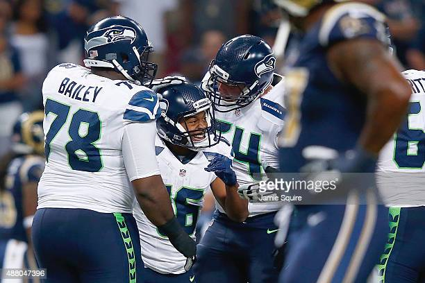 Tyler Lockett of the Seattle Seahawks celebrates a punt return for a touchdown against the St Louis Rams in the first quarter at the Edward Jones...