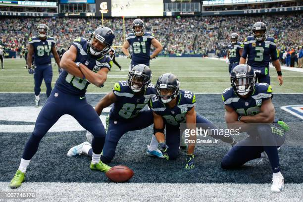 Tyler Lockett of the Seattle Seahawks celebrates a second quarter touchdown with teammates in the game against the San Francisco 49ers at CenturyLink...