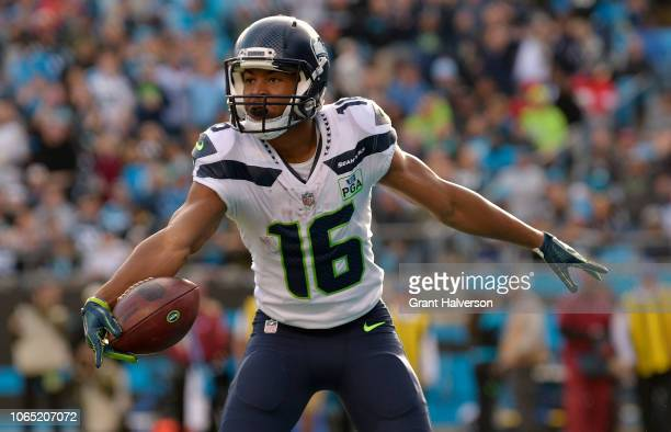 Tyler Lockett of the Seattle Seahawks celebrates a touchdown against the Carolina Panthers in the third quarter during their game at Bank of America...