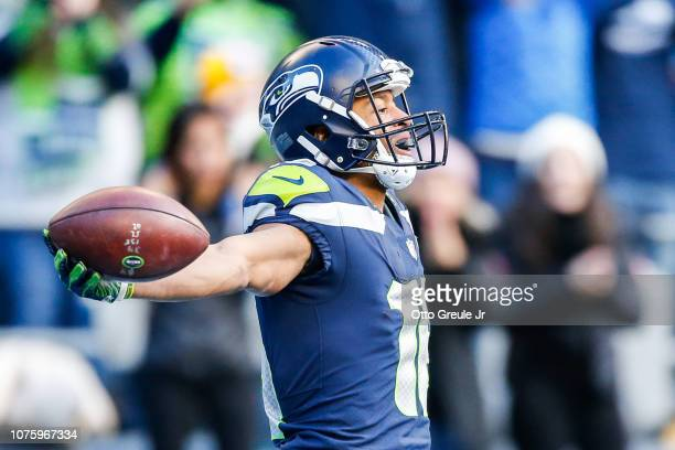 Tyler Lockett of the Seattle Seahawks celebrates after a touchdown in the first quarter against the Arizona Cardinals at CenturyLink Field on...