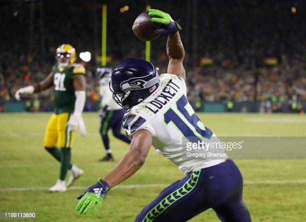 Tyler Lockett of the Seattle Seahawks celebrates after scoring a touchdown during the third quarter against the Green Bay Packers in the NFC...