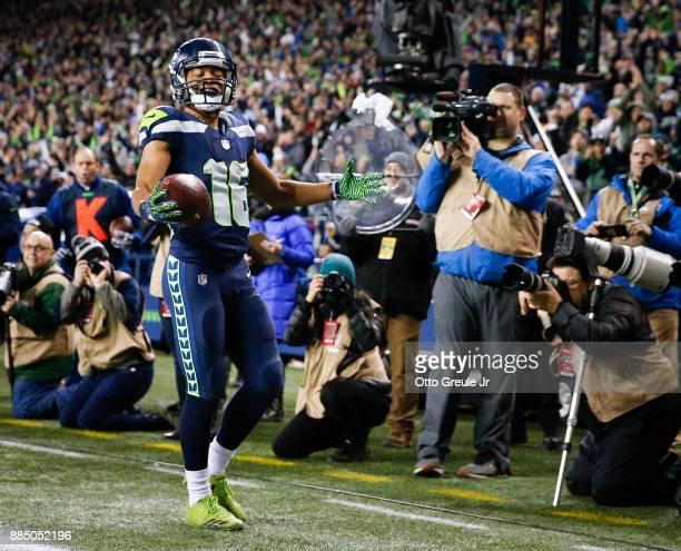 Tyler Lockett of the Seattle Seahawks celebrates his 1 yard touchdown against the Philadelphia Eagles at CenturyLink Field on December 3, 2017 in...