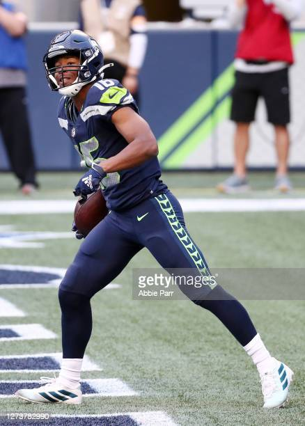 Tyler Lockett of the Seattle Seahawks celebrates scoring a first quarter touchdown against the New England Patriots at CenturyLink Field on September...