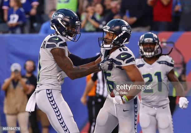 Tyler Lockett of the Seattle Seahawks celebrates with teammate Paul Richardson before his touchdown is called back due to a penalty during the second...
