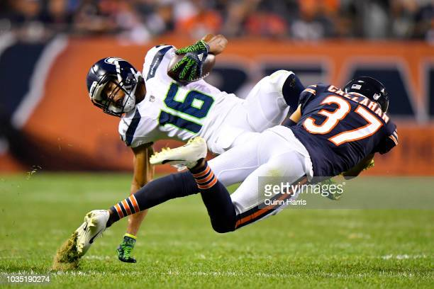 Tyler Lockett of the Seattle Seahawks is hit by Bryce Callahan of the Chicago Bears in the third quarter at Soldier Field on September 17 2018 in...