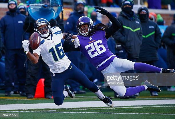 Tyler Lockett of the Seattle Seahawks is unable to catch a pass as he is defended by Trae Waynes of the Minnesota Vikings in the second half during...