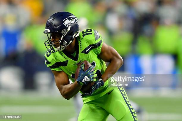 Tyler Lockett of the Seattle Seahawks makes a 12 yard catch from Russell Wilson during the game against the Los Angeles Rams at CenturyLink Field on...