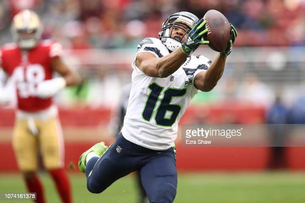 Tyler Lockett of the Seattle Seahawks makes a catch against the San Francisco 49ers during their NFL game at Levi's Stadium on December 16 2018 in...