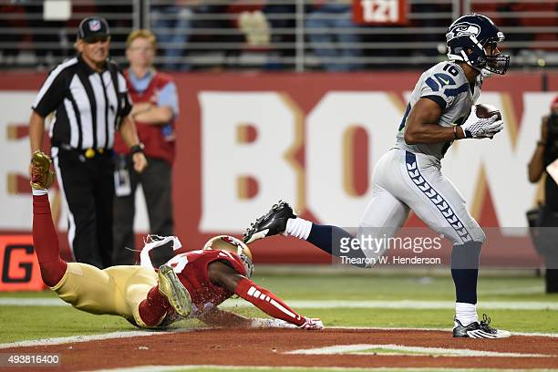 Tyler Lockett of the Seattle Seahawks makes a catch for a 43yard touchdown against the San Francisco 49ers during their NFL game at Levi's Stadium on...