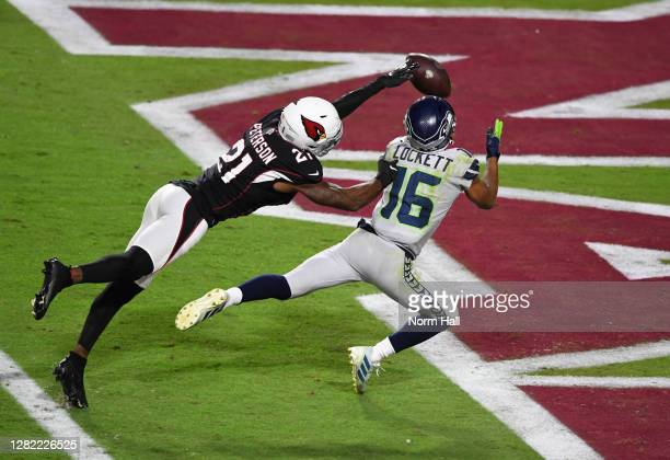 Tyler Lockett of the Seattle Seahawks makes a diving catch for a touchdown against Patrick Peterson of the Arizona Cardinals during the second...