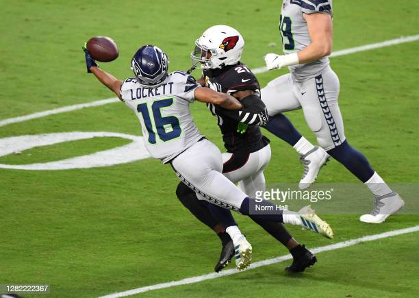 Tyler Lockett of the Seattle Seahawks makes a one handed catch against Patrick Peterson of the Arizona Cardinals during the first quarter at State...