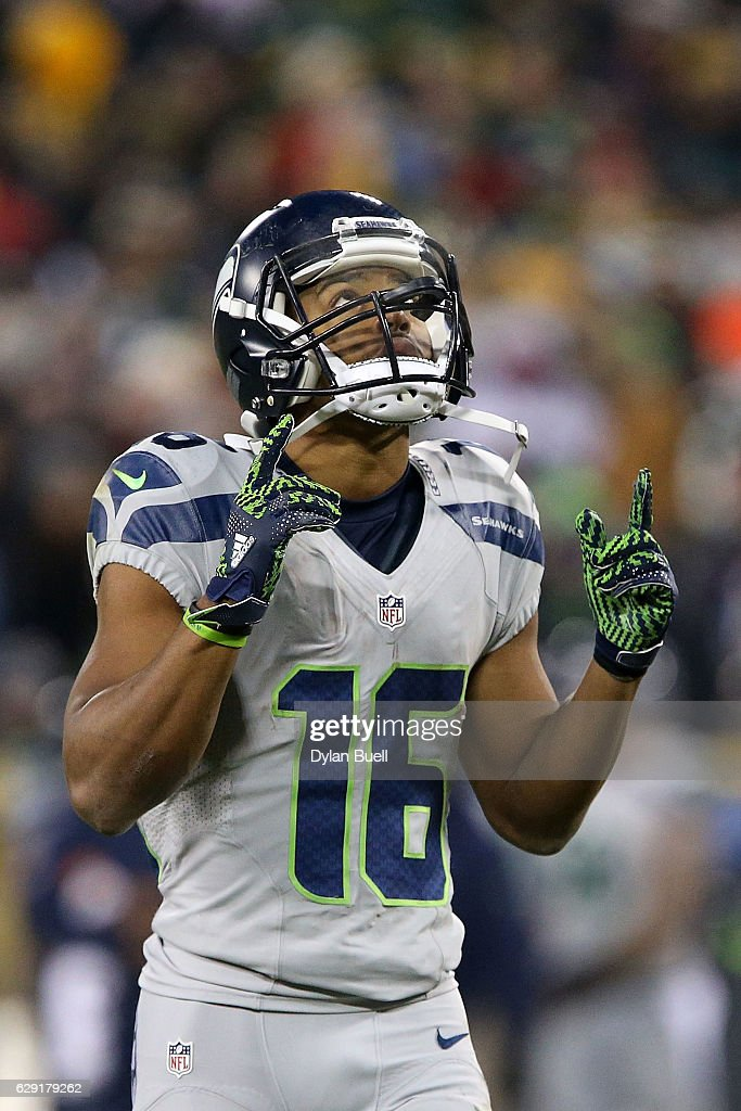 Tyler Lockett #16 of the Seattle Seahawks points to the sky during the second half of a game against the Green Bay Packers at Lambeau Field on December 11, 2016 in Green Bay, Wisconsin.
