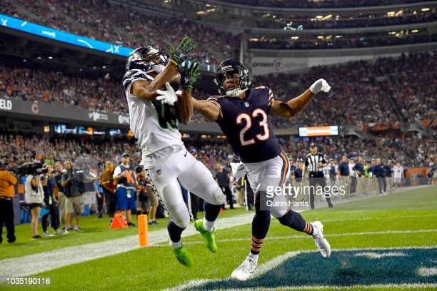 Tyler Lockett of the Seattle Seahawks receives a pass against Kyle Fuller of the Chicago Bears for a touchdown in the fourth quarter at Soldier Field...