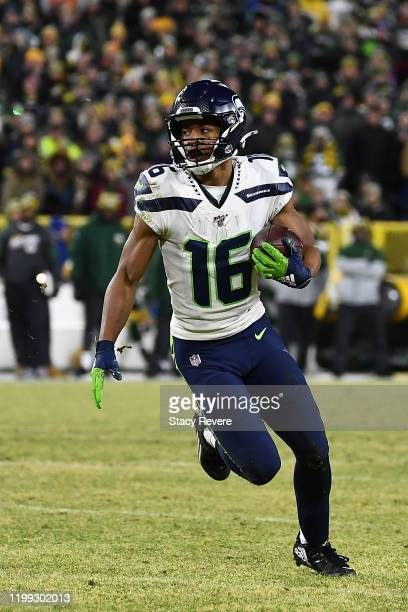 Tyler Lockett of the Seattle Seahawks runs for yards during the NFC Divisional Playoff game against the Green Bay Packers at Lambeau Field on January...