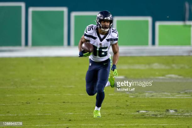 Tyler Lockett of the Seattle Seahawks runs with the ball against the Philadelphia Eagles at Lincoln Financial Field on November 30, 2020 in...
