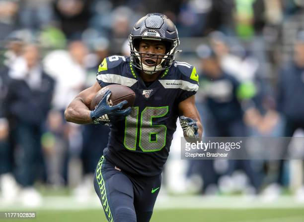 Tyler Lockett of the Seattle Seahawks runs with the ball during game against the New Orleans Saints at CenturyLink Field on September 22 2019 in...
