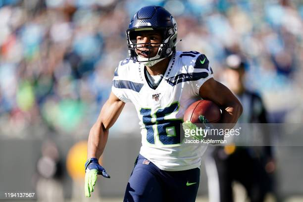 Tyler Lockett of the Seattle Seahawks runs with the ball during the first quarter during their game against the Carolina Panthers at Bank of America...