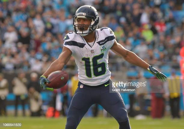 Tyler Lockett of the Seattle Seahawks scores against the Carolina Panthers during the second half of their game at Bank of America Stadium on...