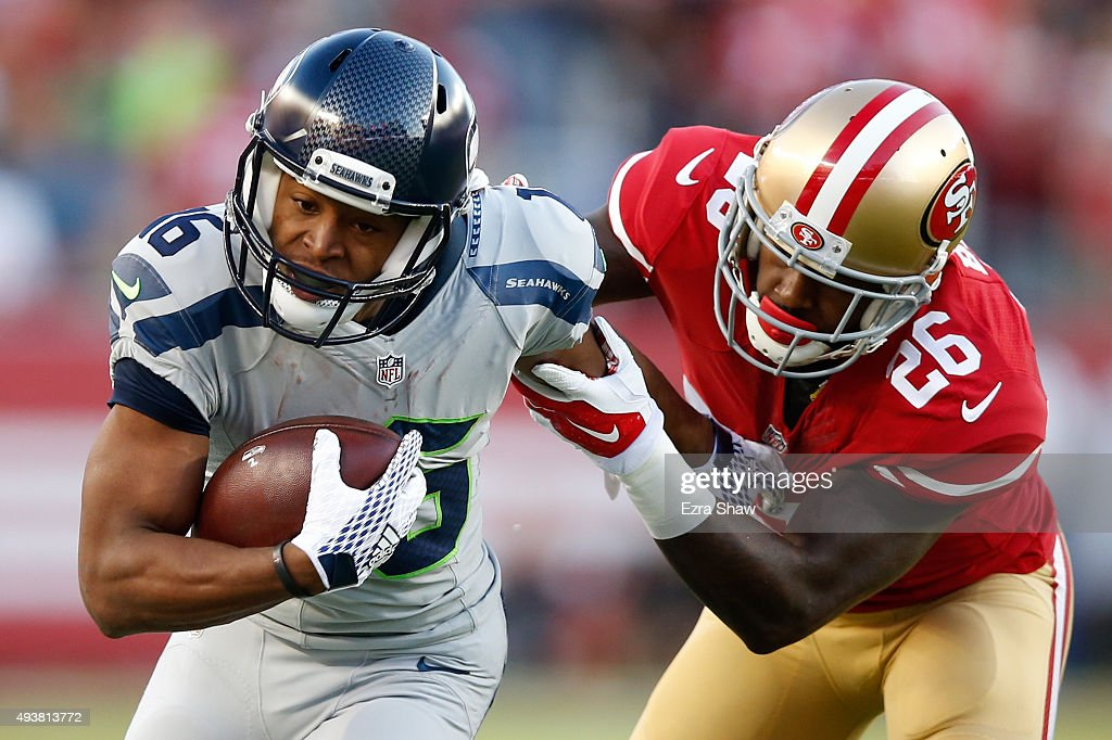 Tyler Lockett #16 of the Seattle Seahawks tries to break a tackle from Tramaine Brock #26 of the San Francisco 49ers during their NFL game at Levi's Stadium on October 22, 2015 in Santa Clara, California.