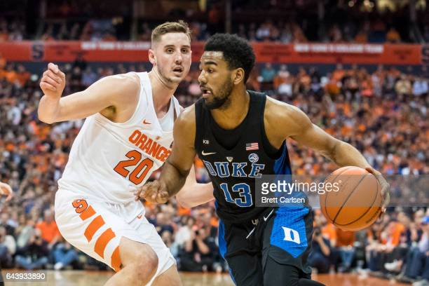 Tyler Lydon of the Syracuse Orange guards as Matt Jones of the Duke Blue Devils drives to the basket during the first half on February 22, 2017 at...